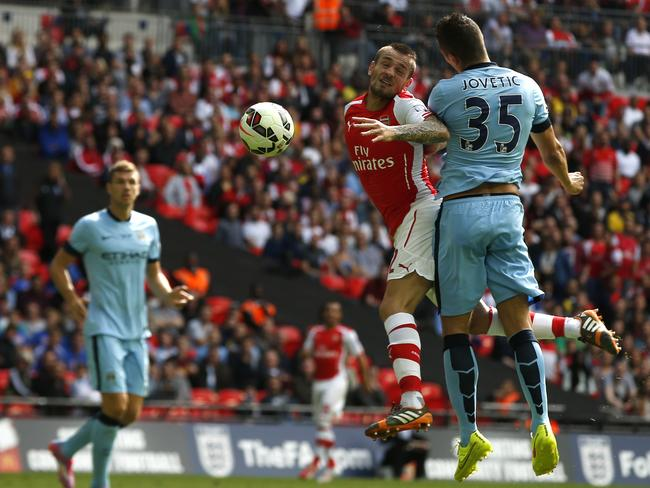 Mathieu Debuchy can't get the better of Stevan Jovetic.