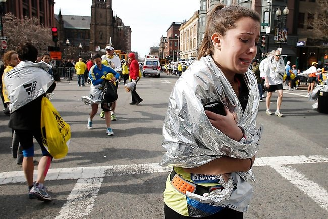 A runner leaves the course crying near Copley Square following the attack. Picture: AP