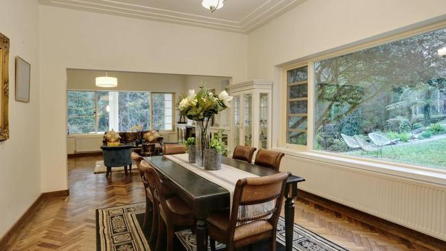 High ceilings, large windows and parquetry floors feature throughout.