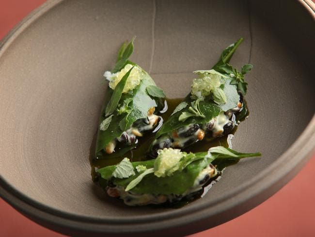 Wattle seed porridge wrapped in salt bush with anise myrtle oil from Noma Restaurant at Barangaroo Sydney. Picture: John Fotiadis