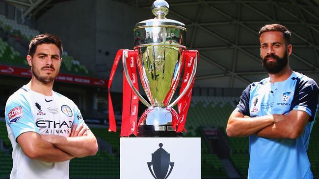 Captains Bruno Fornaroli of Melbourne City and Alex Brosque of Sydney FC pose with the FFA Cup before the match. Picture: Getty Images