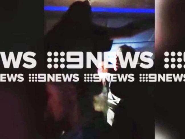 The video captures a passenger yelling at a seated traveller. Picture: 9 News