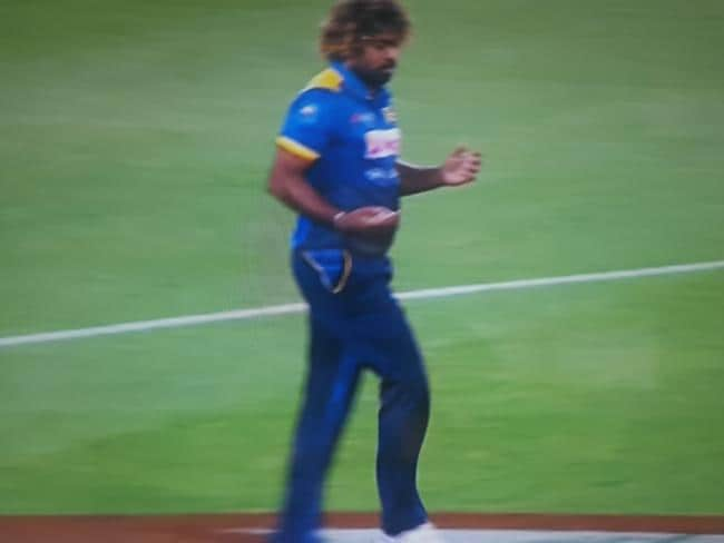 Channel 9 shows Lasith Malinga reaching for a handwarmer.
