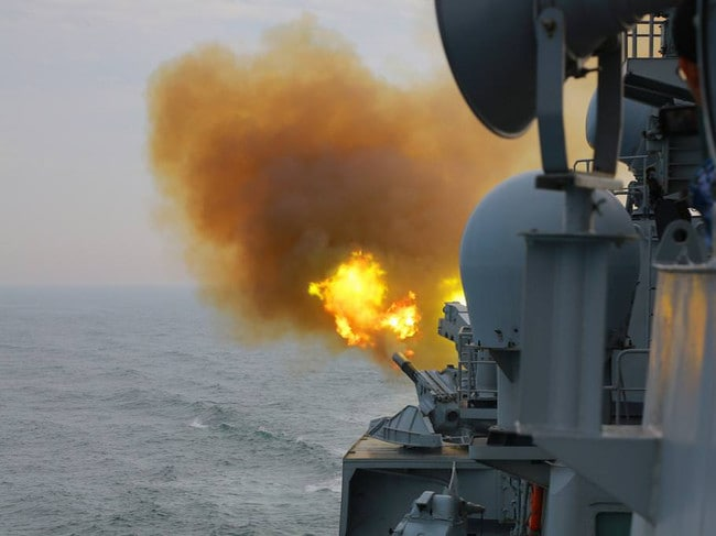 A Chinese warship tests its close-in weapons system during recent live-fire exercises. Picture: Xinhua