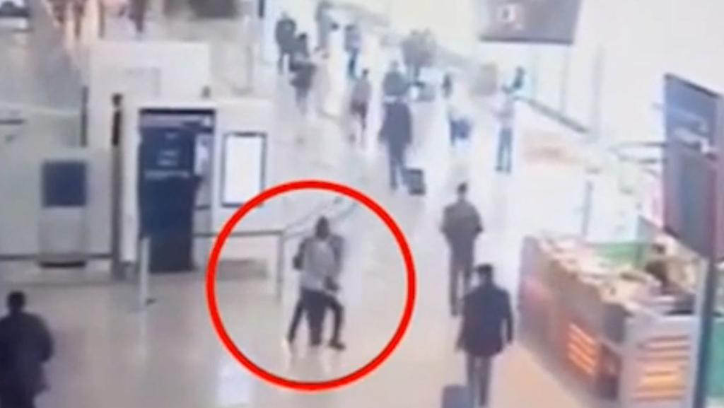 Terrifying CCTV footage shows the moment a man grabs a female soldier from behind before being shot dead at a Paris airport. Picture: AP.