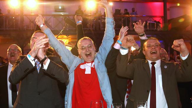 Swiss politician Eric Weber, centre, with AfD supporters. Picture: Alexander Hassenstein