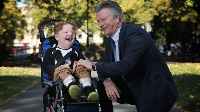 Xavier Kitchin, 5, shares a laugh with Steve Waugh. Picture: LUKE BOWDEN