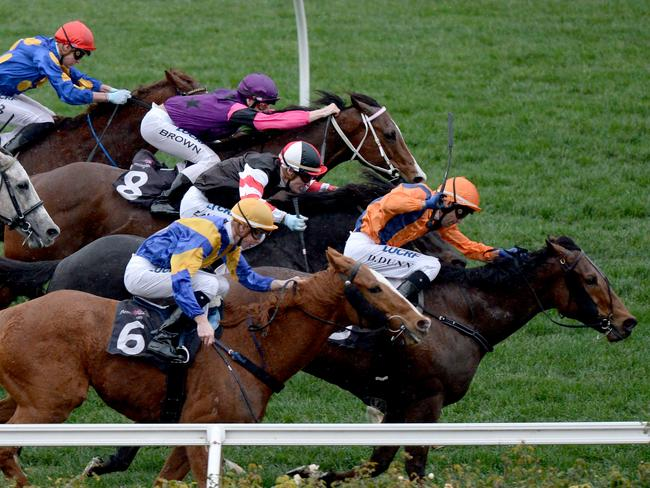 Jockey Dwayne Dunn on Sunday Escape (right) on his way winning the final race. Picture: AAP