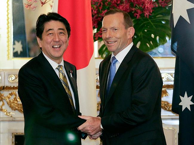 First free trade agreement secured ... Prime Minister Tony Abbott shakes hands with Japan