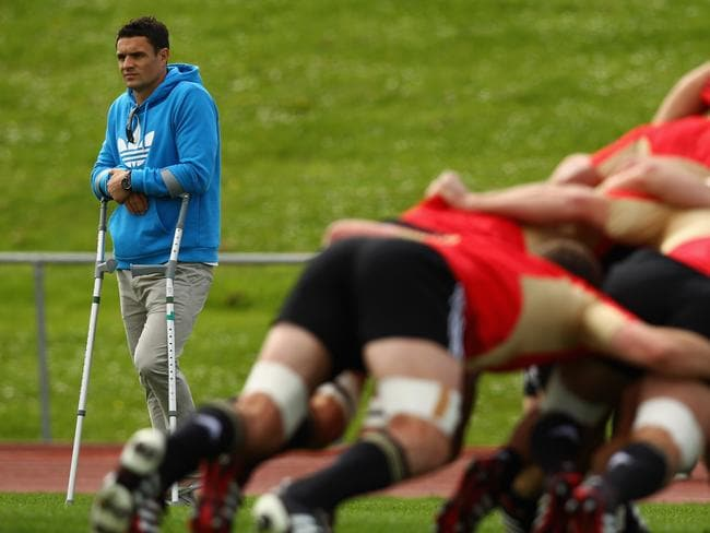 Dan Carter cuts an isolated figure at All Blacks training after being ruled out of the 2011 World Cup.