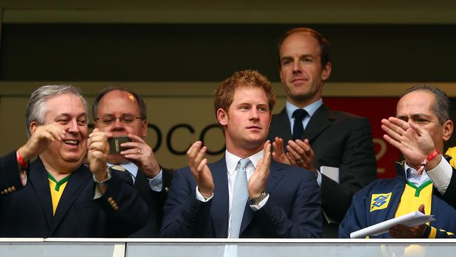 Prince Harry (C) looks on during the 2014 FIFA World Cup Brazil Group A match.