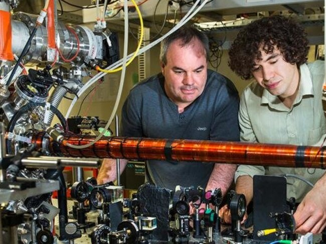Quantum hunters ... Associate Professor Andrew Truscott, left, with PhD student Roman Khakimov. Source: ANU