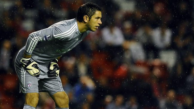 Liverpool goalkeeper Brad Jones concentrates against Northampton Town at Anfield Picture: AFP