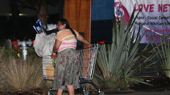 Mary Bobolas's daughter Elena pushes a shopping trolley full of items towards her Bondi hoarders' home. Picture: Bill Hearne.