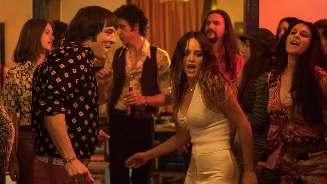 Kissing game...Molly stars Samuel Johnson as Molly Meldrum and Rebecca Breeds as his girlfriend Camille. Picture: Supplied/Seven