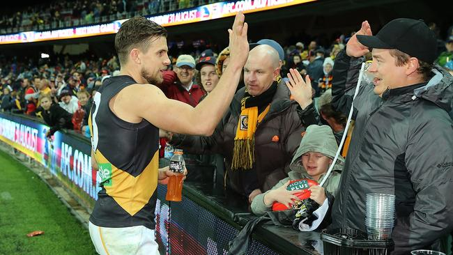 Brett Deledio celebrates a win with the fans.