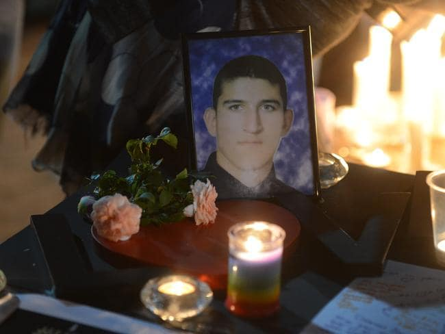 Remembered ... a candle light vigil in memory of Reza Berati.
