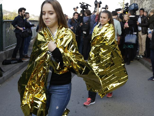 School girls leave their high school after an attack in Grasse, southern France. Picture: AP Photo/Claude Paris