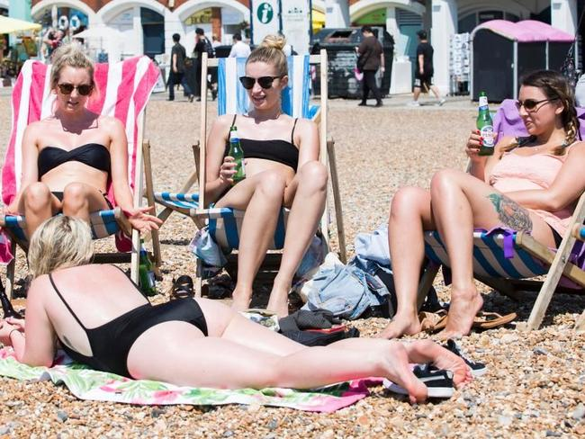 Some pasty white skin turning a lovely shade of pink on Brighton Beach.