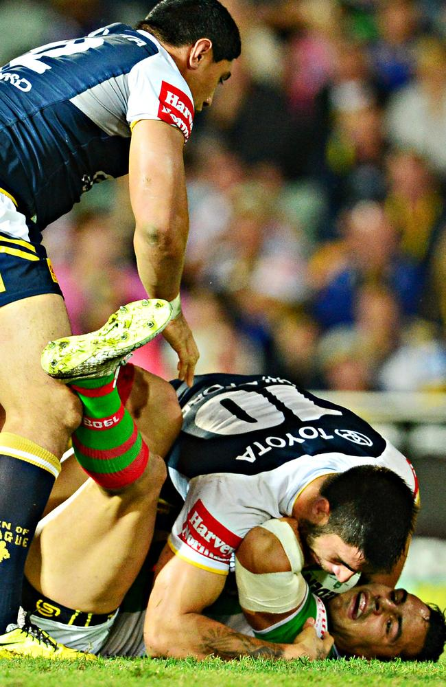 Cowboys players Jason Taumalolo and James Tamou tackle Rabitohs Ben Te'o.