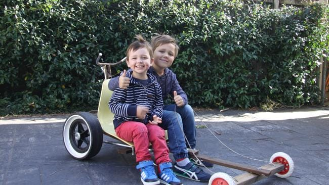 Charlie and Henry Storman made a billy cart with dad James thanks to Pinterest. Picture: Supplied