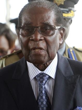 Zimbabwean President Robert Mugabe arrives to make his first public appearance at a graduation ceremony. Picture: AP