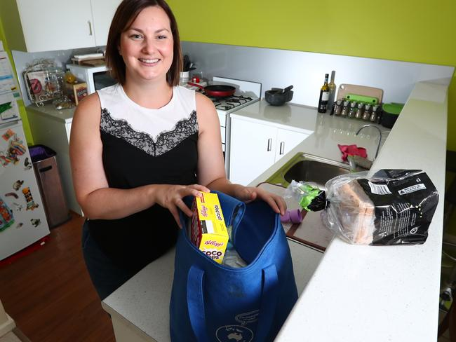 Sarah Markwick at home sorting her shopping. Picture: Tait Schmaal