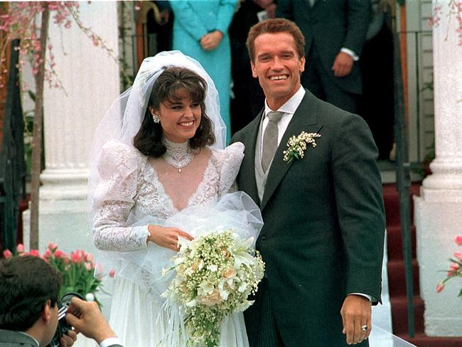 Happier times ... Arnold Schwarzenegger poses with his bride Maria Shriver following their wedding ceremony in Hyannis, Massachusetts in 1986.