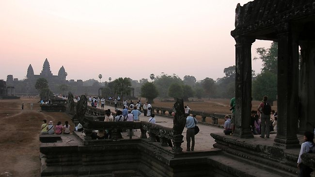 Tourists gather to view sunrise at Angkor Wat temple in Siem Reap province, Cambodia.