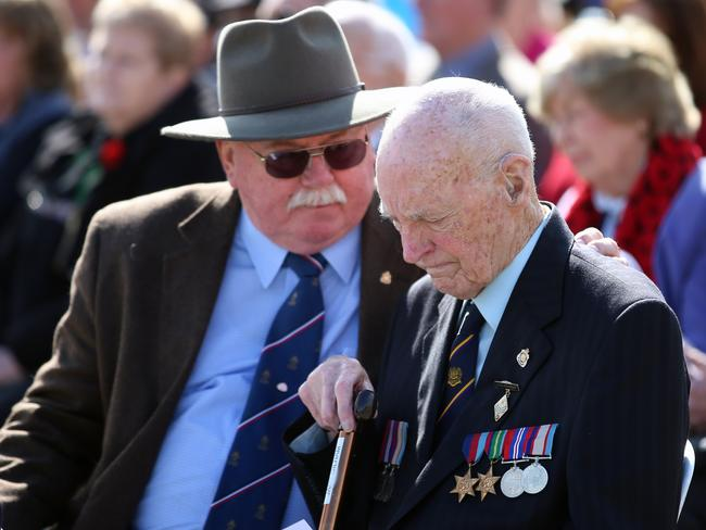 A memorial service ... at The Shrine Of Remembrance in Melbourne marking the end of WWII. Jack Gilham, 91, who was based in New Guinea, for the 20th Pioneer battalion in consoled during the ceremony. Picture: Alex Coppel.