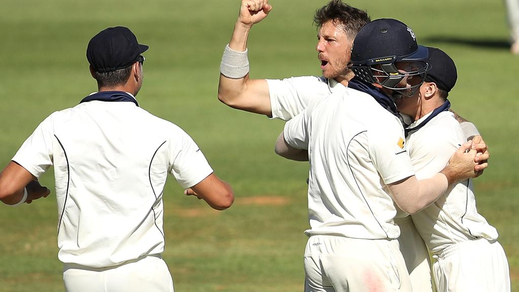 ALICE SPRINGS, AUSTRALIA — MARCH 10: James Pattinson of the Bushrangers celebrates with his team after taking the wicket of Michael Klinger of the Warriors during the Sheffield Shield match between Victoria and Western Australia at Traeger Park on March 10, 2017 in Alice Springs, Australia. (Photo by Mark Kolbe/Getty Images)