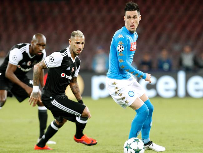 Besiktas' forward from Portugal Ricardo Quaresma (2ndL) fights for the ball with Jose Maria Callejon.