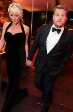 "James Corden and his pregnant wife Julia Carey at the Netflix party. Earlier in the night Corden told E! News: """"I'm here with my wife and she's five months pregnant, so [I'm] mostly just thinking of places that I can hide snacks,"""" Picture: Shutterstock / Splash News"