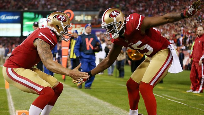 San Francisco 49ers teammates Michael Crabtree (right) and Colin Kaepernick celebrate Crabtree's third quarter touchdown against the Chicago Bears at Candlestick Park. Picture: Ezra Shaw