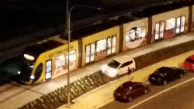LOOK OUT: The driver of this white car had to take evasive action into a slanted garden to avoid this coming tram on Queen Street on Tuesday night