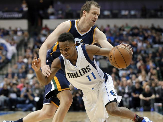 Dallas Mavericks guard Yogi Ferrell works to get past Utah Jazz's Joe Ingles.
