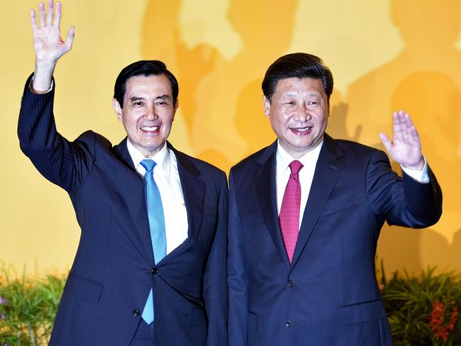 We feel like old friends ... Chinese President Xi Jinping (R) and Taiwan President Ma Ying-jeou wave to journalists before their meeting at Shangrila hotel in Singapore. Picture: AFP