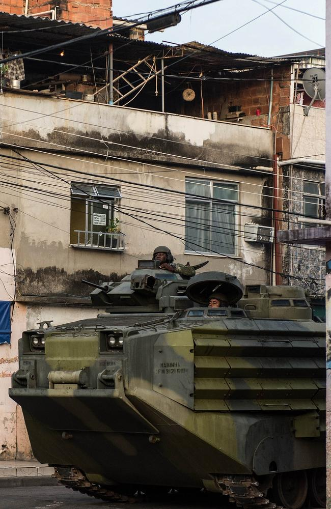 Brazilian marines patrol along the Nueva Holanda favela, part of the Favela da Mare shantytown complex in Rio de Janeiro, in March.
