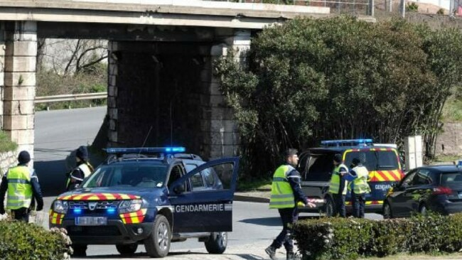 French gendarmes block an access to Trebes, where a man took hostages at a supermarket and two people died. Picture: AFP PHOTO / ERIC CABANISSource:AFP