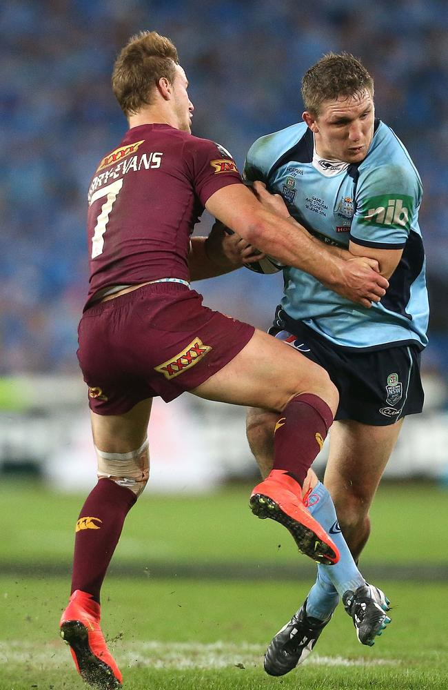 Ryan Hoffman is tackled by Daly Cherry-Evans.