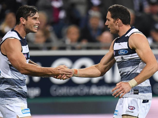 Geelong players Tom Hawkins (left) and Harry Taylor celebrate.