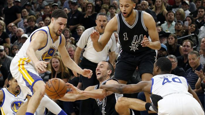 Manu Ginobili of the San Antonio Spurs out-hustles Harrison Barnes of the Golden State Warriors for a loose ball at AT&T Center.