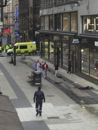 Emergency services work at the scene where a truck crashed into the Ahlens department store at Drottninggatan in central Stockholm. Picture: AFP.