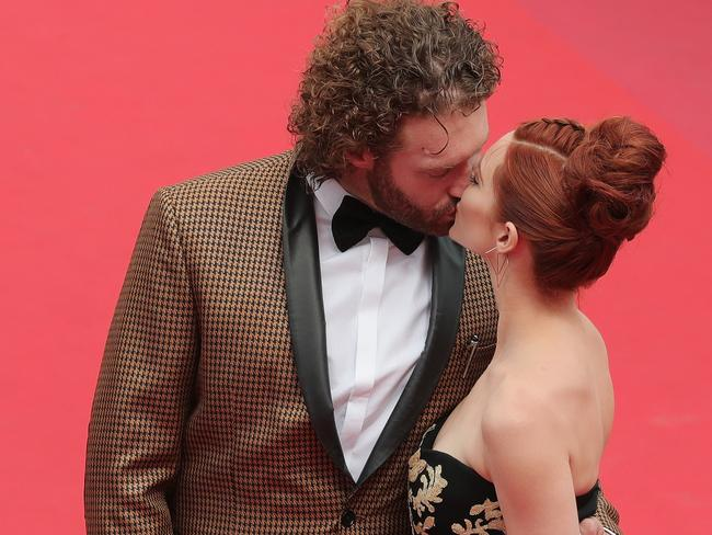 Miller and wife Kate Gorney kiss at last year's Cannes Film Festival. Picture: Getty