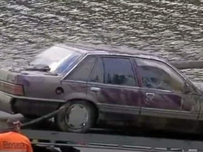 Police divers have retrieved a red VL Holden Commodore from Borumba Dam near Imbil. Photo: 7 News Queensland