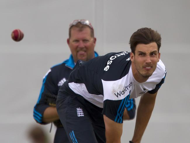 England's Steven Finn bowls during a nets session at Old Trafford cricket ground before the fourth test match.