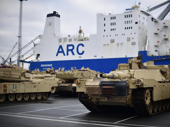 US Army M1 Abrams and other military vehicles stand in line prior being loaded onto trains after being unloaded from ships yesterday. Picture: Getty