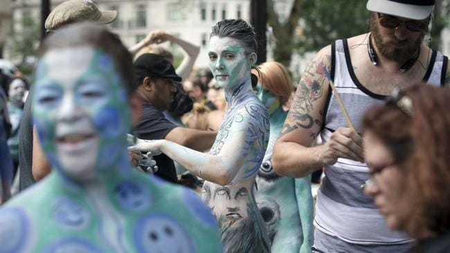 Marion La Coguic, of Portland, Oregon, has the finishing touches added her bodypaint. Photo: John Minchillo.