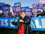 TOPSHOT - Magda Szubanski dances in front of equality ambassadors and volunteers from the Equality Campaign gathering in front of Parliament House in Canberra on December 7, 2017, ahead of the parliamentary vote on Same Sex Marriage, which will take place later today in the House of Representatives. / AFP PHOTO / Sean Davey