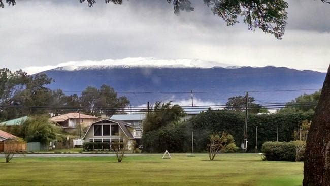 The National Weather Service has issued a winter storm warning for Mauna Kea on Hawaii's Big Island, pictured, which is currently covered in snow. Picture: Grant Matsushige/Canada-France-Hawaii Telescope via AP
